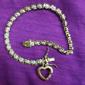 Jewelry - Gold over 925 diamond ruby heart tennis bracelet!